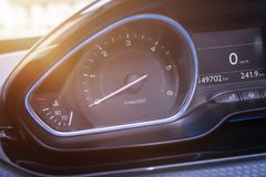 Car tachometer close up. Modern interior with blue led light.  Royalty Free Stock Image