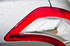 Car tail light with water drop Royalty Free Stock Photos