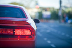 Car tail lights. Red car and tail lights at dusk royalty free stock images