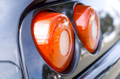 Car Tail Lights. Large round Red car tail lights of a sports car stock image