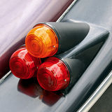 Car tail lights. Three tail lights of an old classic car royalty free stock image