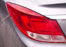 Car Taillight in Raindrops and Dirt Royalty Free Stock Images