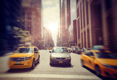 Car and Taxis Driving on New York City Street Royalty Free Stock Photos