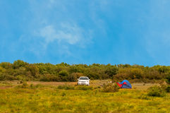 Car and tent outdoors. Car and tent close to forest Stock Image