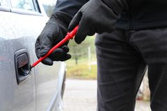 Car theft with screwdriver 3 Royalty Free Stock Photo