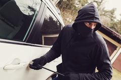 Car theft - thief trying to break into the vehicle stock photos