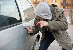 Car thief. In action meaning car insurance protecion
