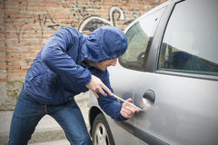 Car thief city. Thief stealing automobile car  in the city street Stock Images