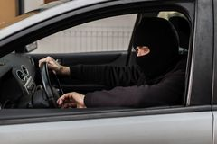 Car thief driving a stolen car. Royalty Free Stock Photography