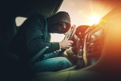 Car Thief in Mask and Glasses Royalty Free Stock Photo