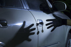 Car thief. At parking lot Royalty Free Stock Photography