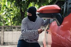 Car thief tries to accessing and unlock a car by remote control stock photo