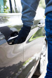 Car Thief Trying Door Handle To See If Vehicle Is Locked Stock Image