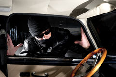 Car thief. Thief trying to steal a car Stock Images
