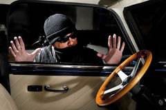 Car thief. Thief trying to steal a car Royalty Free Stock Photography