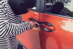 Car thief trying to unlock a car by screwdriver.  Stock Photography