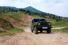 Car in Tien-Shan mountains Royalty Free Stock Photography