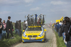 The Car of Tinkoff Saxo Team. Carrefour de l'Arbre,France-April 13,2014: The technical vehicle of Tinkoss Saxo team driving in front of a cyclists on the famous Royalty Free Stock Image