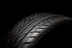 Car tire. Photo on the black background Royalty Free Stock Photography