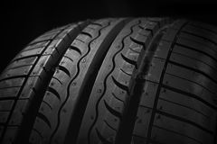 Car tire. New car tire on black background Stock Images