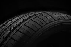 Car tire. New car tire on black background Royalty Free Stock Images