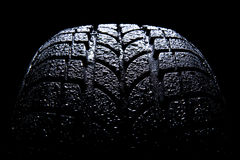 Car tire. Isolated on black background Royalty Free Stock Photography