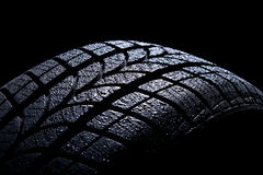 Car tire. Isolated on black background Stock Photos