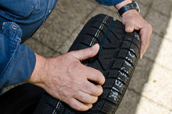 Car tire. Man holding new car tire Stock Photography