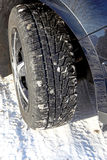 Car tire. In the winter way Royalty Free Stock Photo