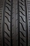 Car tire. On black background Royalty Free Stock Photos