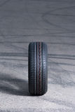 Car tire. A new car tire on the road Royalty Free Stock Photo