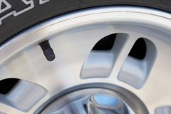 Car tire. Wheel, and valve stem Stock Photography