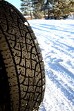Car tire. In the winter way royalty free stock images