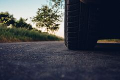 Car tire on asphalt Stock Image