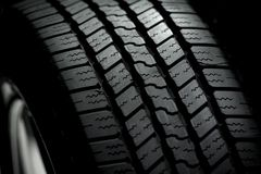 Car Tire on Black. Background. Car Tire in the Dark - Spot Light Stock Photo
