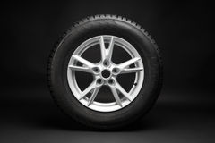 Car tire on black background Royalty Free Stock Photo