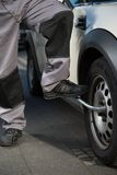 Car tire change with the help of a feet Royalty Free Stock Image