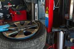 Car tire changing. Car mechanic changing a tire Stock Images
