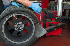 Car tire changing Stock Images