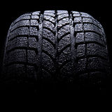 Car tire close-up. Car tire isolated on black background Royalty Free Stock Images