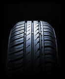 Car tire. Close-up in low light royalty free stock photo