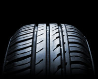 Car tire. Close-up in low light stock image