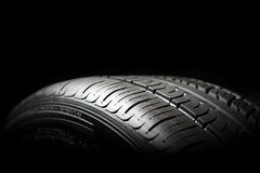 Car tire close-up. Wheel profile structure on black background Royalty Free Stock Photo