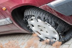 Car tire completely damaged after leak and continue driving. Tire blowout defect failure.  Royalty Free Stock Image