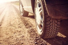 Car tire on dirt road Stock Photography