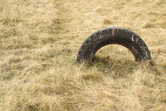 Car tire dug into the earth Royalty Free Stock Photo