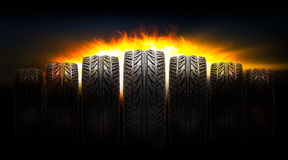 Car tire with fire. Rubber car tire with fire blaze on dark background royalty free stock photos