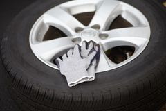 Car tire and gloves Royalty Free Stock Images