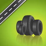 Car tire on green background Stock Image
