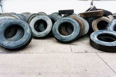 Car tire heap align on cement ground, used tires Royalty Free Stock Images